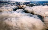 AERIAL clouds over snowy mts