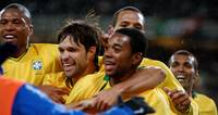 brazil players celebrate Robinho goal