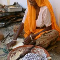 Indian Woman Making Bread Art Prints & Posters by Martin Ferrier