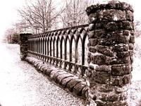 Stone wall and wrought Iron