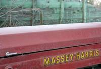 Massey Harris Tractor in a junkyard.