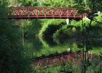 Reflections of a footbridge