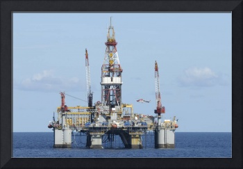 Offshore oil rig with and helicopter