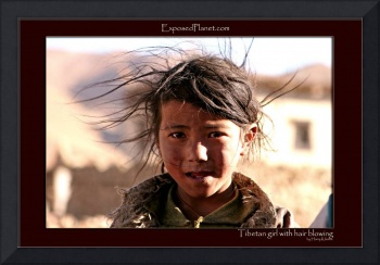Tibetan girl with dirty hair blowing