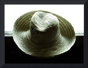 Straw hat against the window