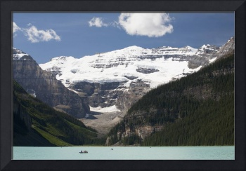 Mount Victoria And Lake Louise With Canoes In The