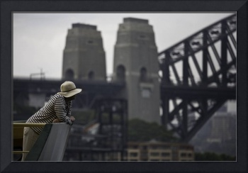 Woman on ferry with Harbour Bridge backdrop