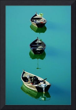 Small boats at mirror
