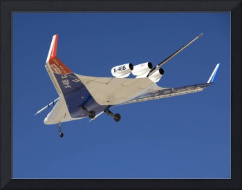 The Blended Wing Body X48B soars through the sky
