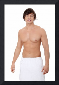 Handsome, happy young man with the towel.