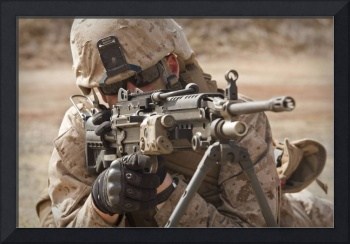 A squad automatic weapon gunner provides security