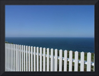 Romantic Beach Walk Scene with White Fence