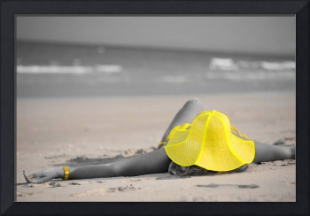Woman in yellow hat on the beach