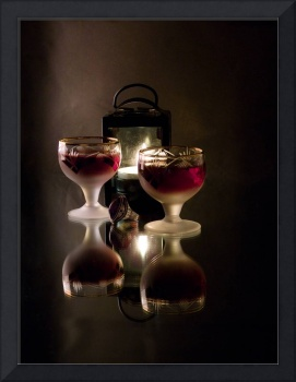 Romantic still life with wine, a ring and a lamp.