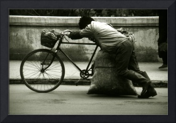 Man Pushing Bike in Beijing