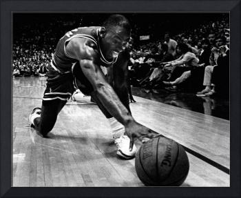 Michael Jordan reaches for the ball