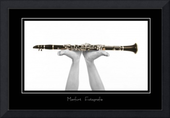 clarinet pushed up by woman's naked feet