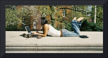 Side profile of a girl using a laptop