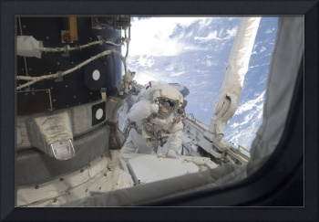 An astronaut participates in the a session of extr