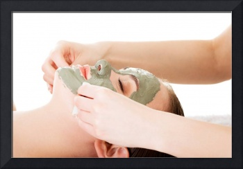 Beauty treatment in spa salon. Woman with facial c