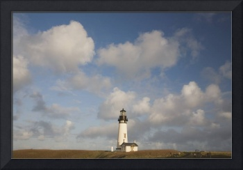Lighthouse With Cloudy Backdrop