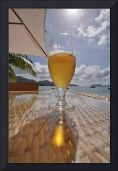glass of beer on beach table