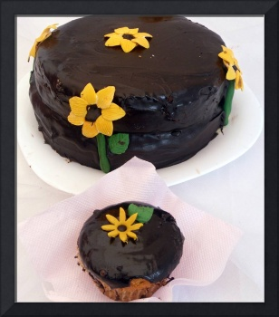 Brown cream cake with cupcake