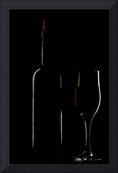 light silhouette of bottle and wineglass
