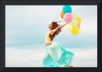 Young Girl's Happiness On the Beach With Balloons