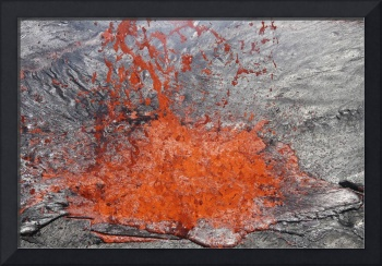 Lava bubble bursting through crust of active lava