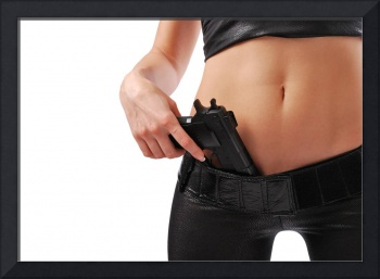 Female hand with pistol and sexy body in black