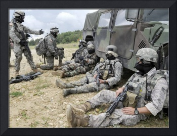 U.S. Air Force and Army members take a rest after