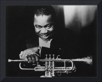 Louis Armstrong holding trumpet