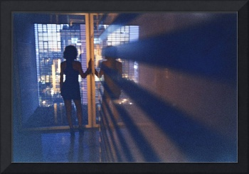 Slim young lady in hotel corridor analog film phot