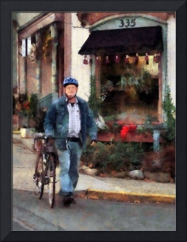 Man Crossing Street With Bicycle
