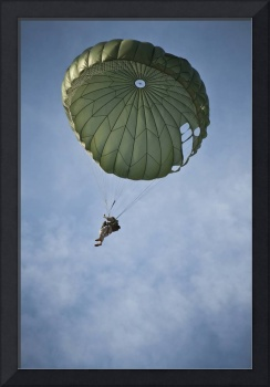 An Airman descends through the sky after a static-