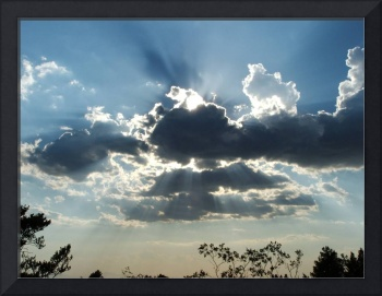 A cloudy skyscape with sun rays