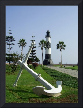 Anchor and Lighthouse on the green coast