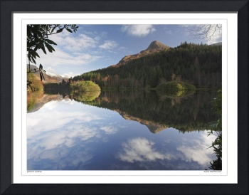 Reflection on a Lochan at Glencoe, Scotland UK