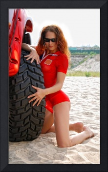Sexy woman near the tire of the red jeep