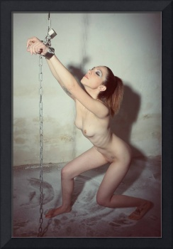 Nude woman cuffed and chained