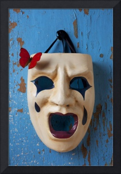 Crying mask and red butterfly