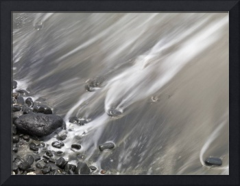 Water Lapping Up Against A Rocky Shoreline