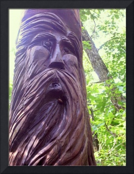 Carving of Old Man with Beard