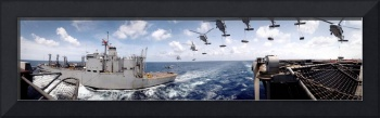 SH60 helicopters transfer ammunition between USS H