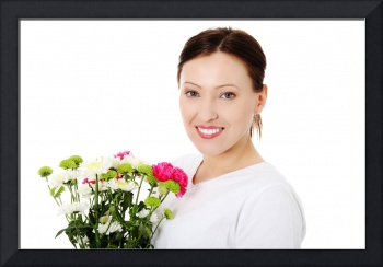 Smiling adult woman with bouquet.