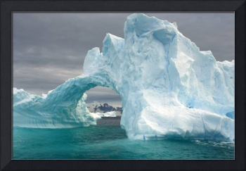 Arched iceberg floating off the Western Antarctic