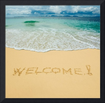 welcome  written in the beach