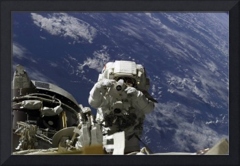 Astronaut uses a digital still camera during a spa