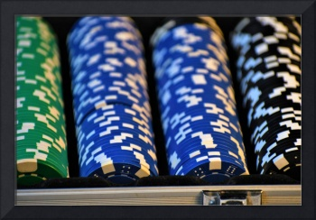 Green, Blue and Black Chips Organized In Case